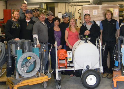 BayGreen Repair Specialist Tom (on far right) at on-site training with KECO staff